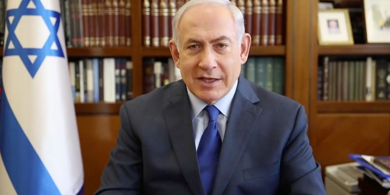 Netanyahu slams media for attacks on him as thousands rally in support