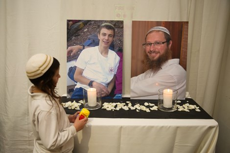 The pictures of Natanel and Ya'akov Litman displayed at the wedding.