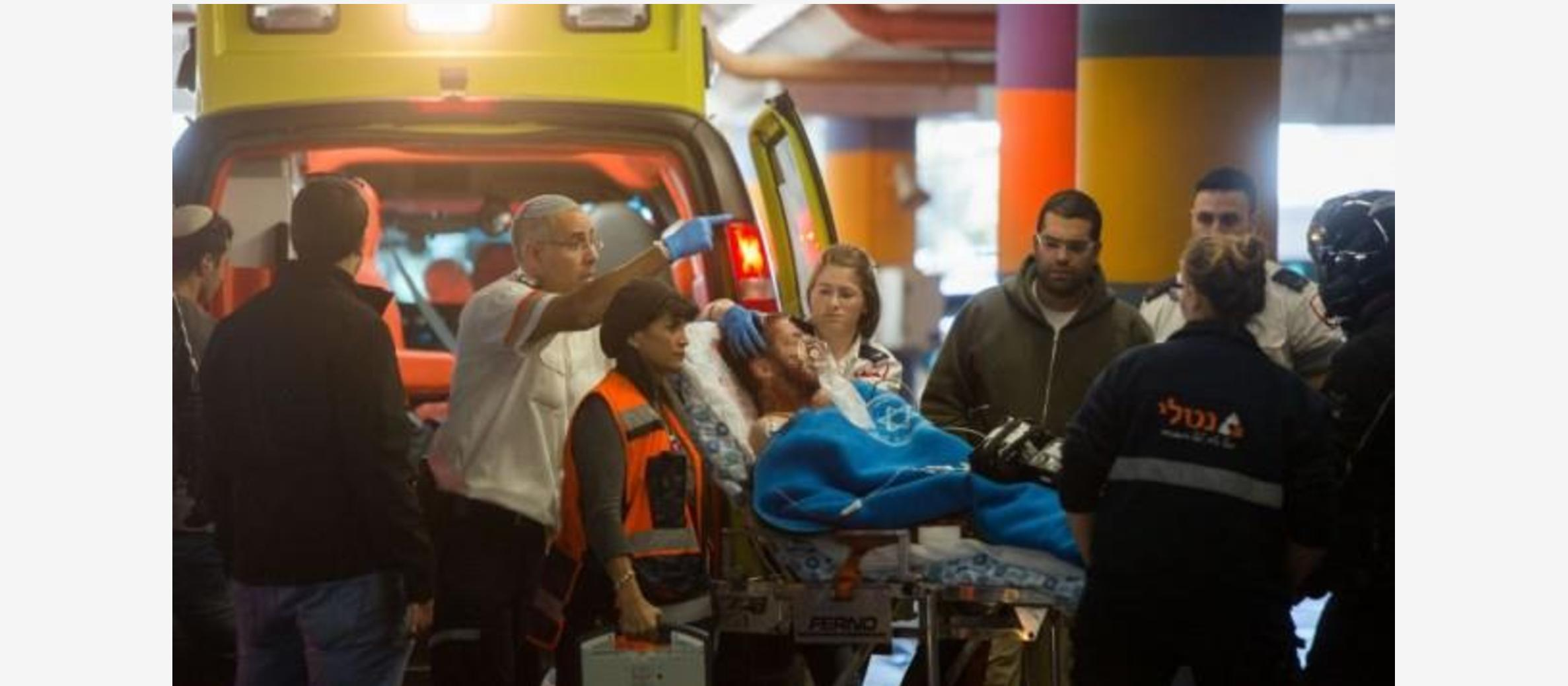 Two Israelis stabbed in Hebron; Couple injured in drive-by shooting