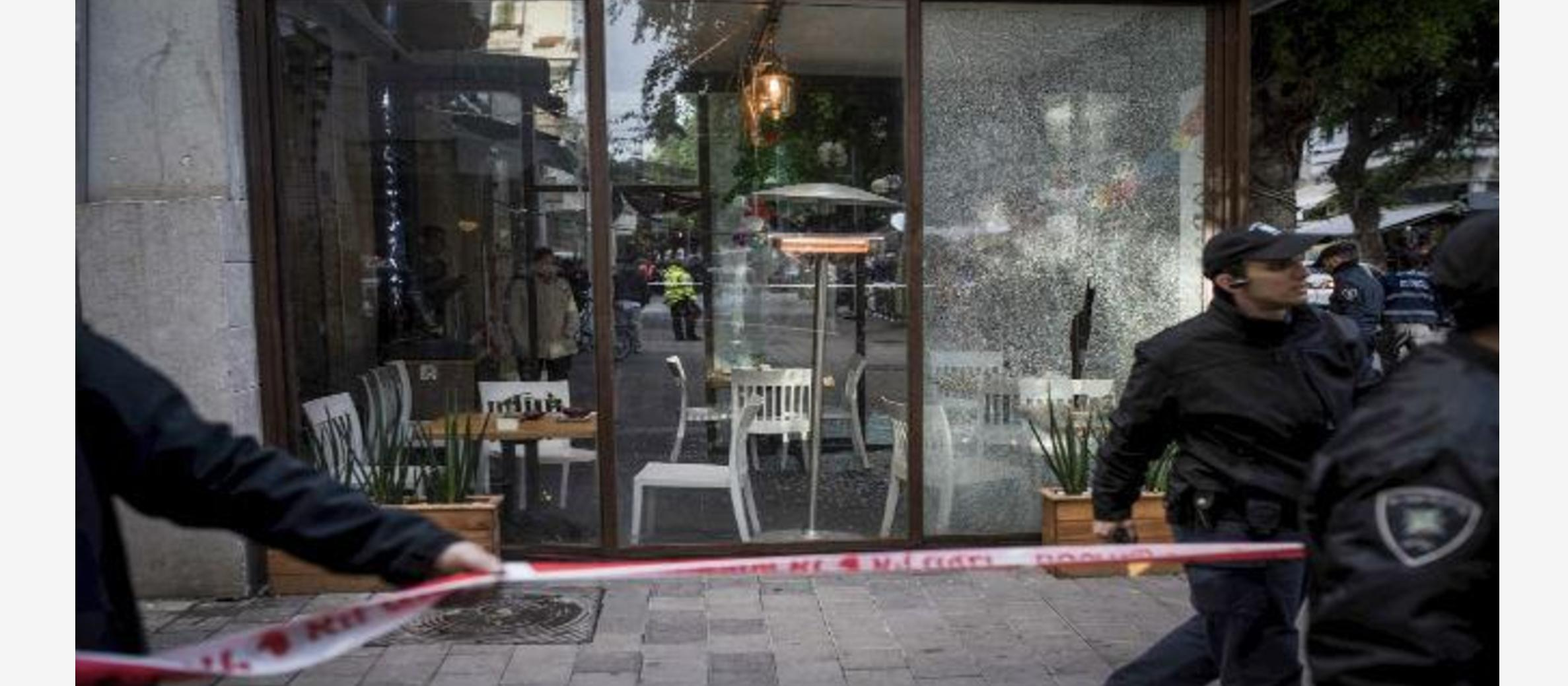 Assailant in Tel Aviv bar attack remains at large as city remains on alert