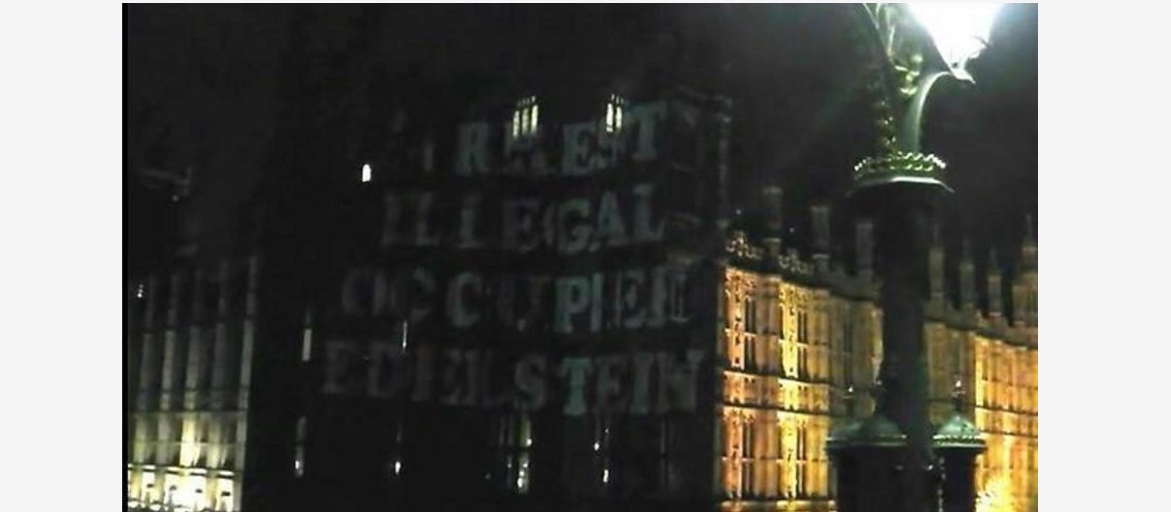 Anti-Israel activists project hostile messages on Houses of Parliament ahead of Knesset speaker visit