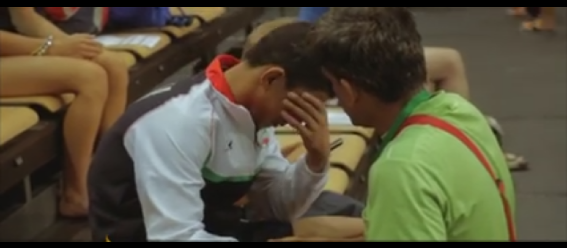 Iranian teen wrestler bursts into tears when coach makes him forfeit to avoid Israeli