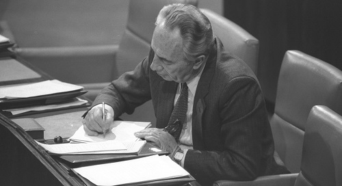 PRIME MINISTER PERES TAKING NOTES IN HIS SEAT IN  THE KNESSET.