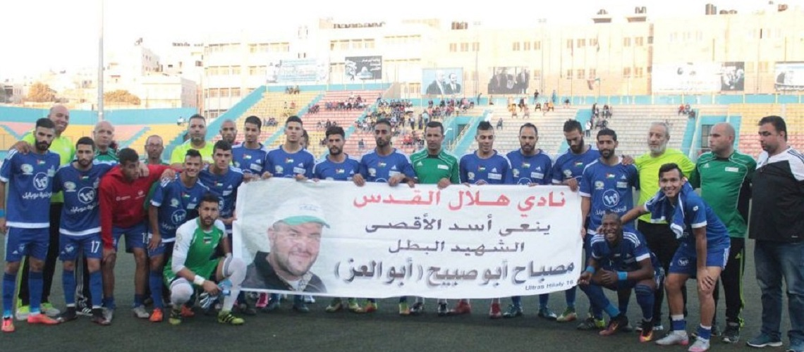 Palestinian soccer team poses with poster of Jerusalem terrorist