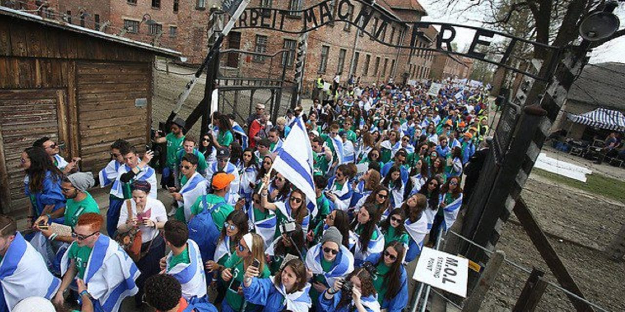 Thousands of Jewish young people march at Auschwitz for March of the Living