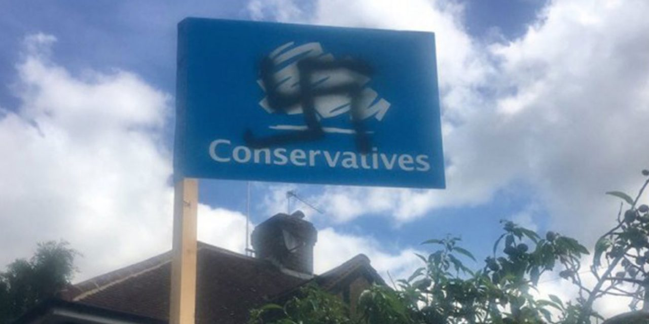Conservative election placards defaced, some with swastikas