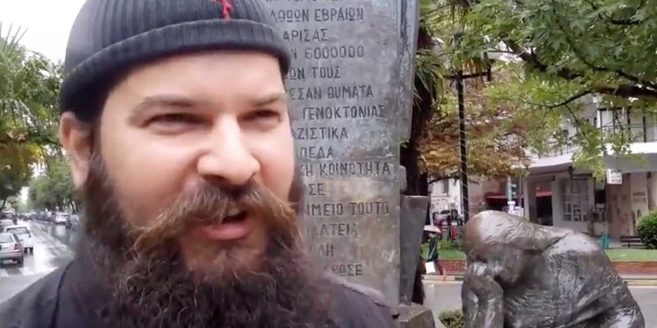 Watch: Greek Orthodox Monk desecrates Holocaust monument while spouting hate