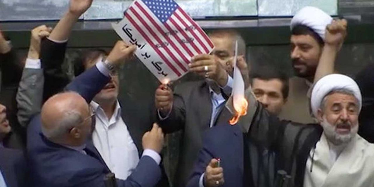 "Iranian politicians chant ""Death to America"" and burn US flag"