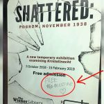 "Poster for Kristallnacht exhibition defaced with ""Free Palestine"" at London tube station"