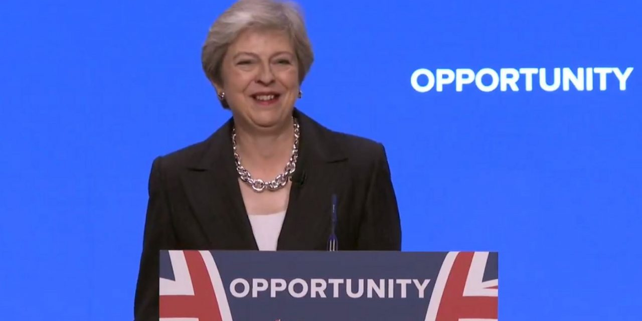 """Theresa May takes aim at Corbyn's """"bogus solutions"""" to anti-Semitism in conference speech"""
