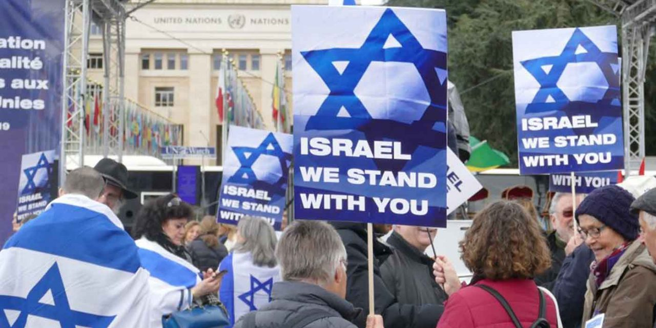 Israel supporters protest the UN's anti-Israel bias in Geneva