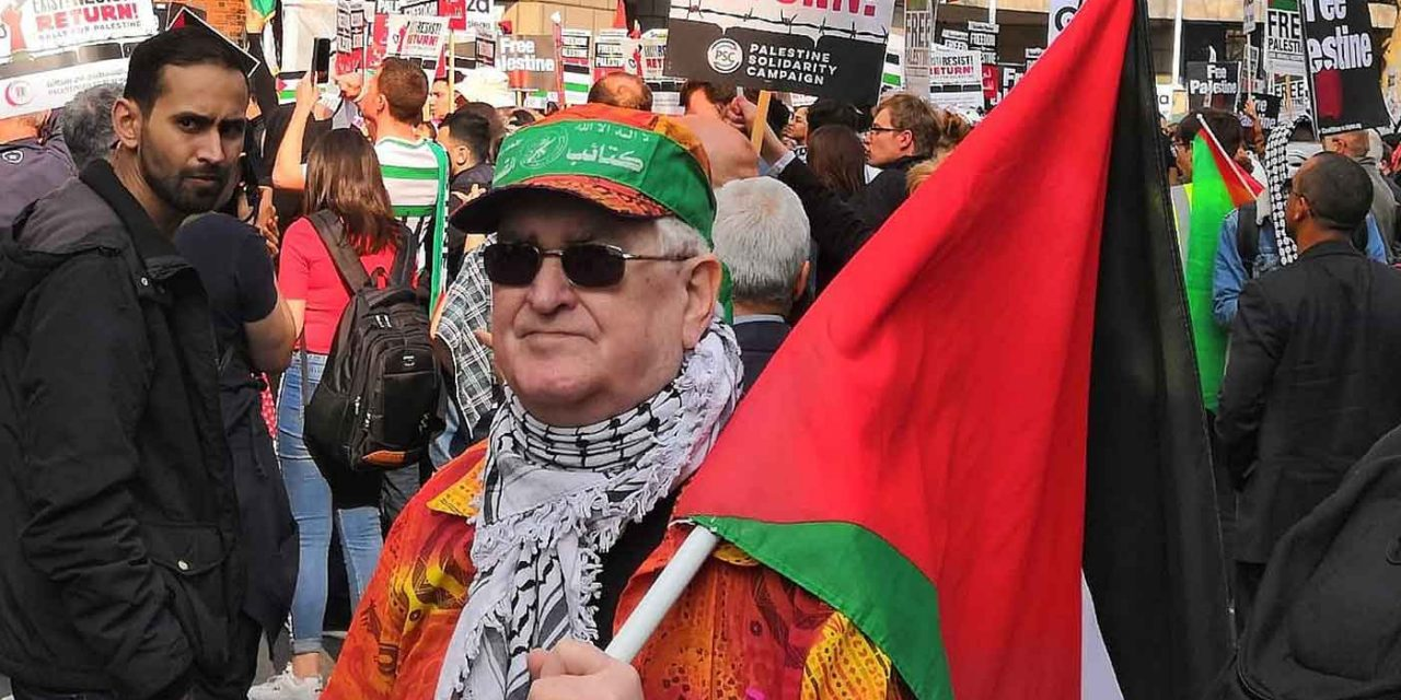 London police urged to probe Hamas terror bandanna at anti-Israel protest last week