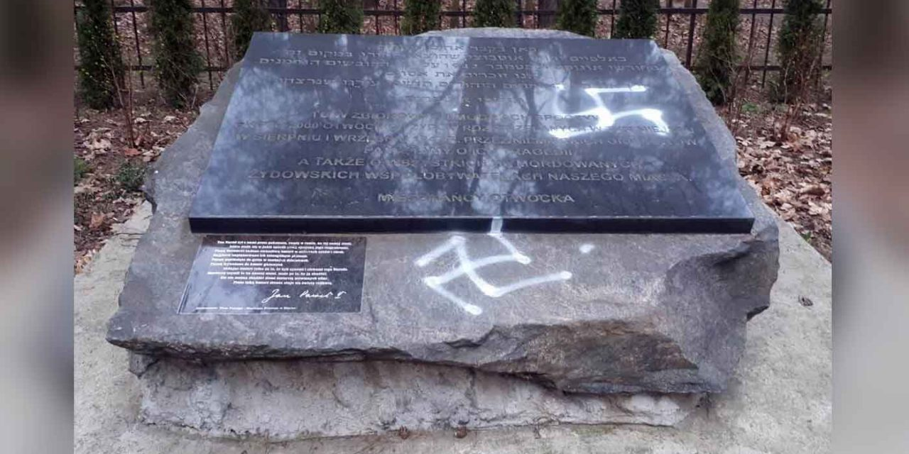 Poland: Swastikas daubed on memorial stone at Holocaust mass grave
