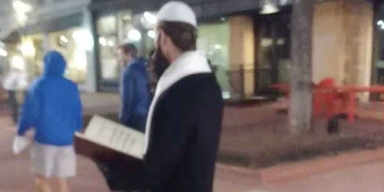 Men dressed as Jews hand out Holocaust denial flyers in Colorado
