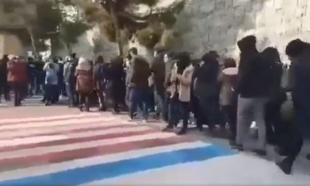 WATCH: Iranian students AVOID walking over giant US and Israel flags