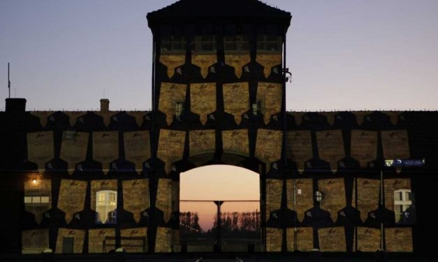 10,000 virtual memorial plaques projected on gates of Auschwitz for Holocaust Remembrance Day