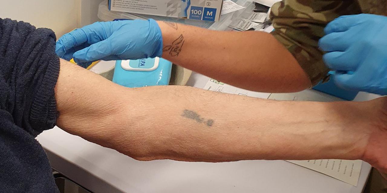 Picture of Auschwitz survivor, 93, getting jab on tattooed arm goes viral
