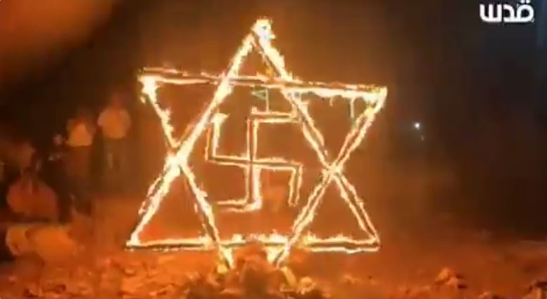 Palestinian protesters burn Star of David and swastika